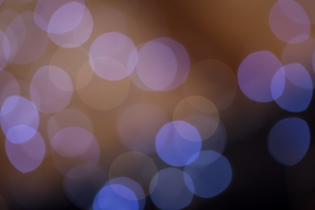 darkness: Background bokeh of sparkling defocused party lights twinkling in the darkness conceptual of a celebration, Christmas or New Year