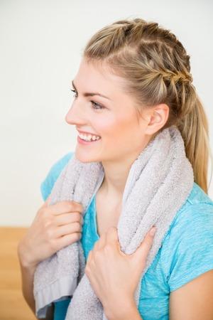 Cute young blond woman in sportswear