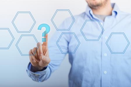 Business man closeup click hexagon button with question mark Stock Photo
