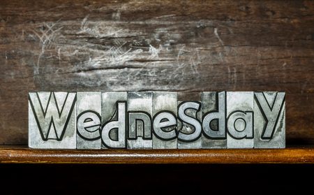 The day of the week Wednesday created with movable type printing on a shelf