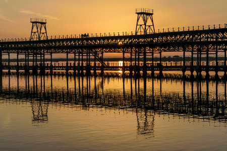 Sunset over the Rio Tinto Pier, Huelva, Andalusia, Spain