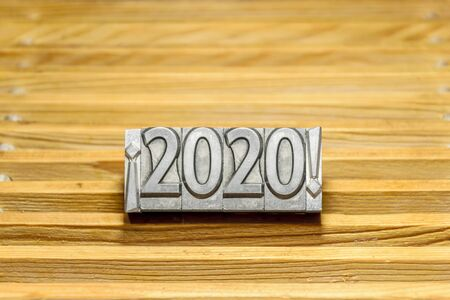 Happy new year 2020 on wooden slats background with types of press between exclamation marks Archivio Fotografico