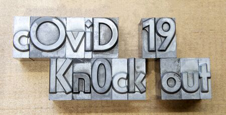 Knock out Covid 19 created with mobile type printing celebrating victory over pandemic 版權商用圖片