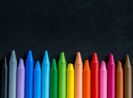 crayons with black background