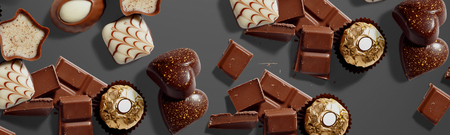 Background with chocolates, Long banner format Imagens