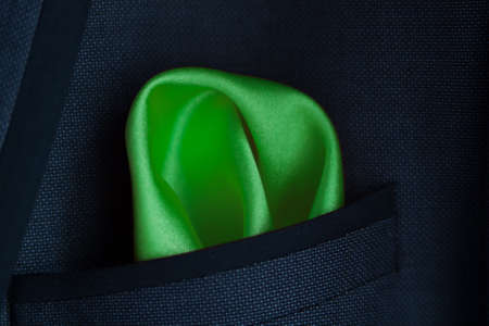 lose up of a green handkerchief in a jacket pocket