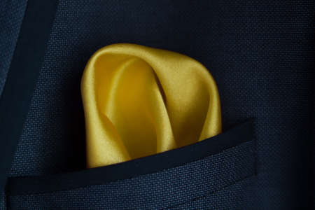 close up of a Yellow handkerchief in a jacket pocket Stock Photo