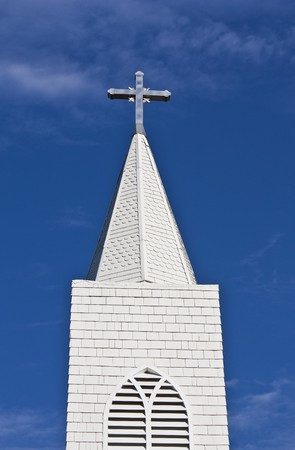 steeples: Looking up at a church steeple and cross