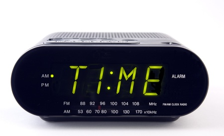 alarm clock: A Clock radio with the word TIME