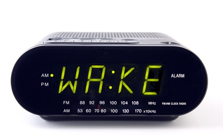 clock: A Clock radio with the word WAKE