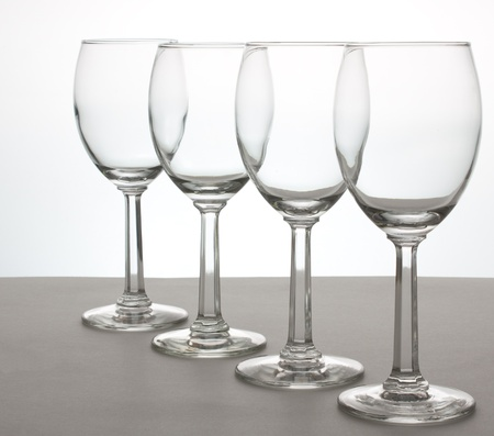A row of 4 wine glasses at an angle Stok Fotoğraf