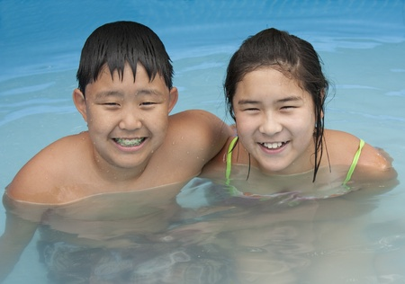 A Korean boy and girl in a swimming pool