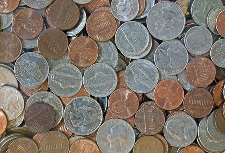 Close-up of quarters, dimes, nickels and pennies photo