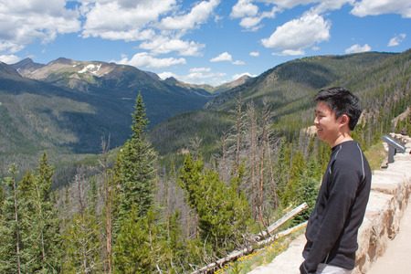 Profile of a teenage boy looking at the mountains Stok Fotoğraf