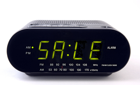 A Clock radio with the word SALE