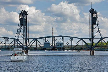 Boat approaching the lift bridge on the St. Croix river at Stillwater, MN
