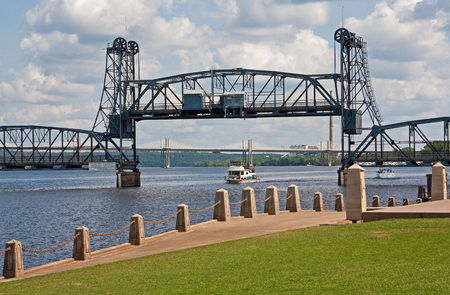 Boat going under the lift bridge on the St. Croix river at Stillwater, MN