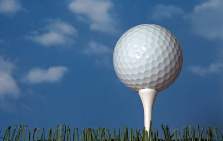 Looking up at a golf ball on a tee