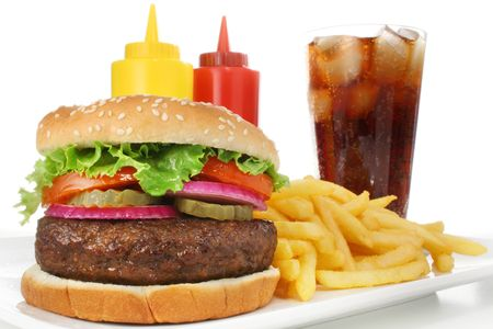 Hamburger meal served with french fries and soda close-up photo