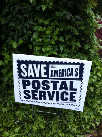 Lawn sign pleading to save the postal service.