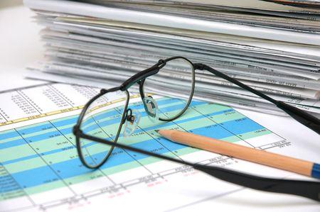 numerics: Stack of bills and spreadsheet