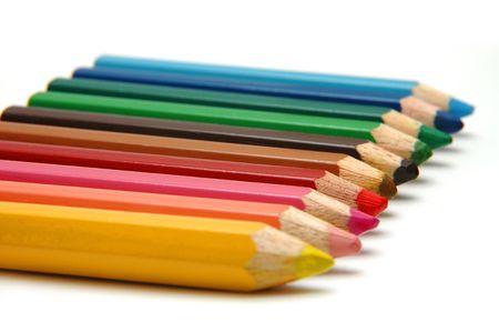 arrange: Neatly arrange Color Pencils. Focus is on Red Colour