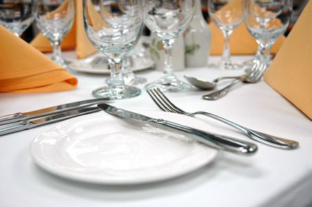 Ready for a formal dinner of fine dining. Focus on the bread plate Stock Photo