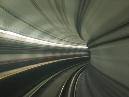 View of a tunnel from a moving train