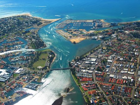 residential settlement: Aerial View of Coastal Town. View of River Mouth