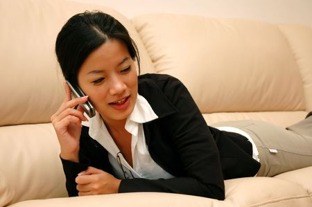 woman chatting on phone (warm colors)