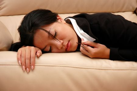 power nap: woman taking a nap on the couch Stock Photo