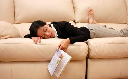 woman taking a break from reading