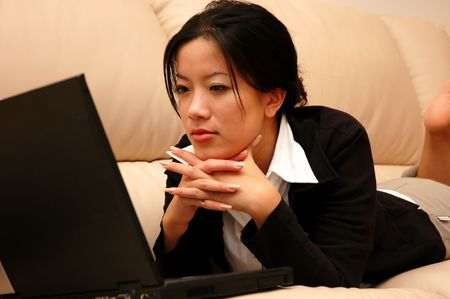 Woman thinking about the next move Stock Photo