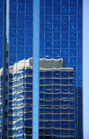 Reflection off glass tower photo