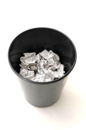 toppled: Bin half Filled with Trash