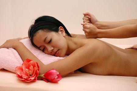 Woman at Spa enjoying a massage session