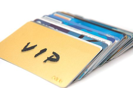 cashless: Stack of cards used on a daily basis. Low Depth of Field Stock Photo