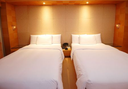 A warm and cosy bedroom in a hotel