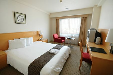 A clean and spartan hotel room