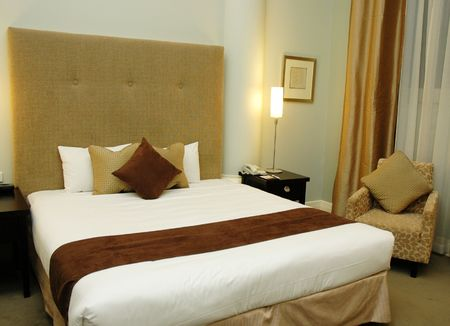 king bed: Spacious and nicely deocrated room. Brown Theme with King Bed