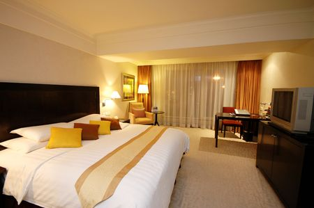 king bed: Spacious and nicely deocrated room. Gold Theme with King Bed