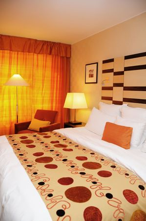 king bed: Spacious and nicely deocrated room. Orange Theme with King Bed Stock Photo
