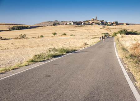 pilgrim journey: a Spanish landscape with pilgrims walking the road