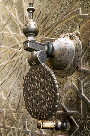 golden knocker on a door Morocco
