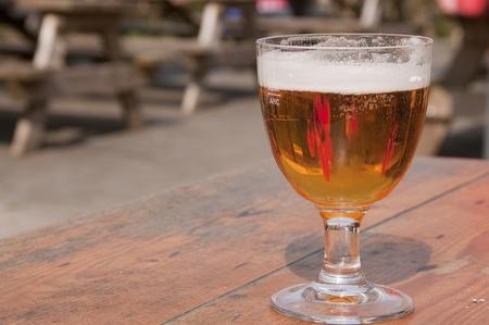 Glass of foaming beer, Belgium