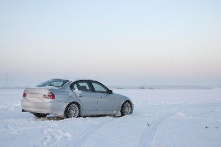 Car in the snow, Holland Stock Photo