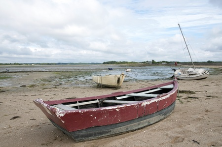 upright row: Rowing boat on a beach, France