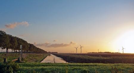 holand: Sunrise over windmills. Holand Stock Photo