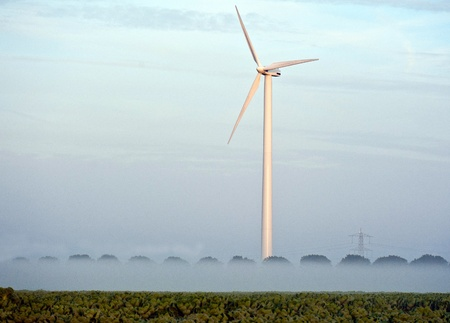 Windmill and trees in the fog, Holland photo