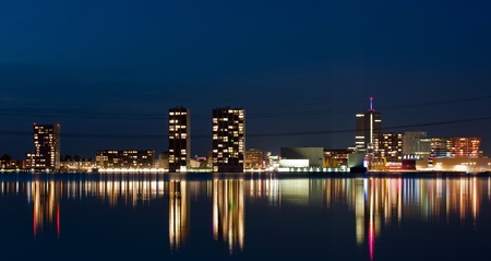 Skyline of a city at night, Almere, Holland Stock Photo